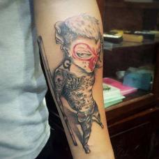 手臂拿金箍棒的社会猴纹身图片