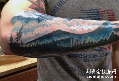 手臂山脉和天空纹身图片