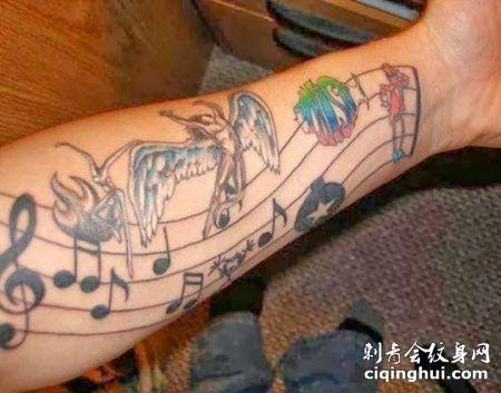 手臂五线谱天使纹身图案