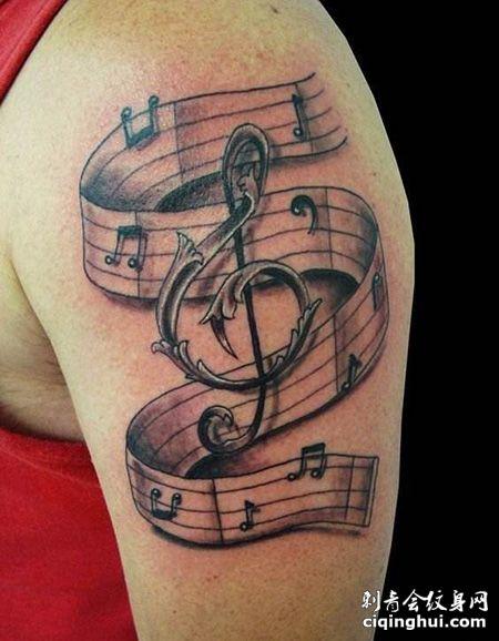大臂创意五线谱纹身图案