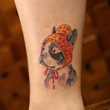 手臂可爱的卡通小狗纹身图案