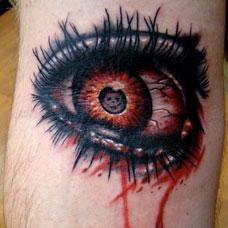 小腿上流血的眼睛纹身图案
