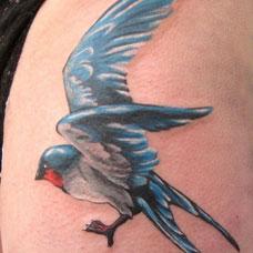 大腿蓝色燕子纹身图案