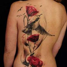 背部个性罂粟花纹身图片