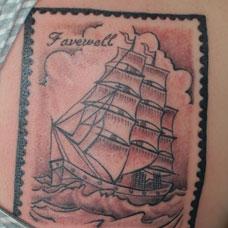 背部个性的帆船邮票纹身图案