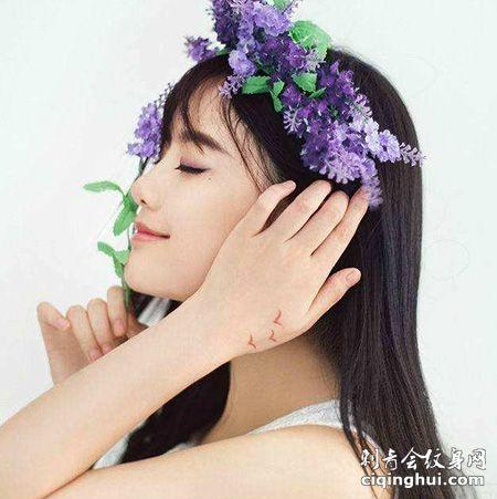 小清新南笙姑娘侧脸虎口纹身图片